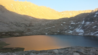 As the sun sets, the light in the valley moves away and plays games on the surface of Guitar lake.