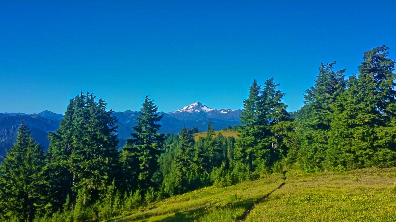 Glacier Peak in the distance. Glacier Peak Marks the final big mountain sentinel on the PCT.