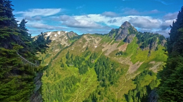 Reaching another crest and ridge between steep climbs in the Pacific Northwest.