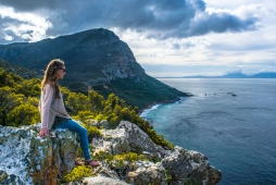 Darwin's sister looks out at the False Bay vista on a short trail in Cape Point National Park.