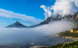 The road along the water in Cape Town is worth a drive, and with a bunch of pull outs, photo opportunities are everywhere. Here, from Ouderkraal Beach, Lion's Head and Table Mountain burst out of the fog.