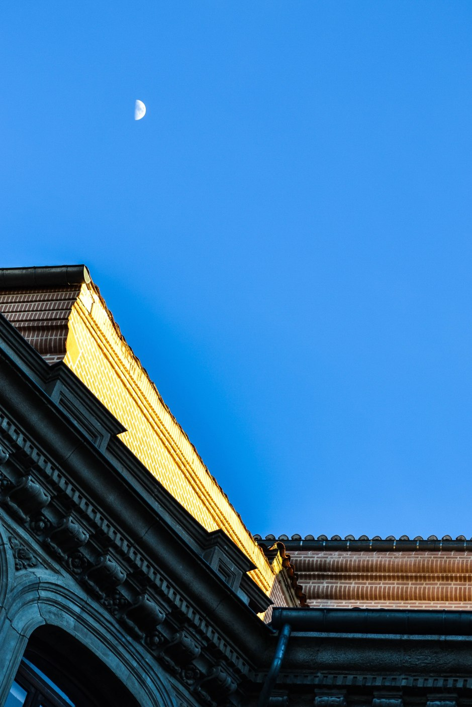 Walking around the old town of Madrid near Puerta del Sol. Look up and be amazed.