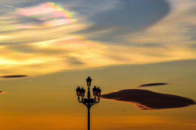 Sunset in front of the Palacio Real de Madrid left a few rainbow clouds to enjoy from down below.