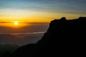 Sunrise on the Drakensberg Rim. The hiker is an Afrikaans friend named Gustav Greffrath, a guide who will take you up into the Berg with his company Itchy Feet.