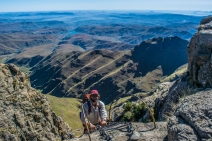 Climbing a chain ladder from South Africa into Lesotho.