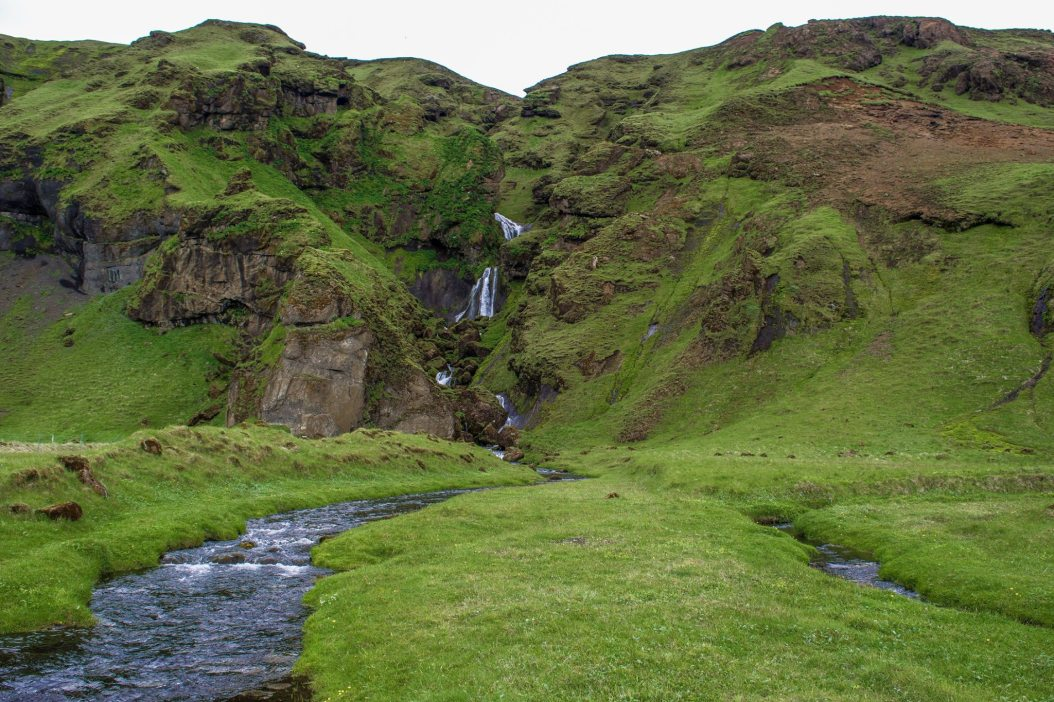 This multi-tiered waterfall has an awesome stealth camp. From this perspective, just to the right is a small ravine with a brook. You can pitch a few tents in there and be out of the view of other people. You can also park your car not far from where this shot was taken. This waterfall is located East of Vik for a few minutes, and can be seen from the road.