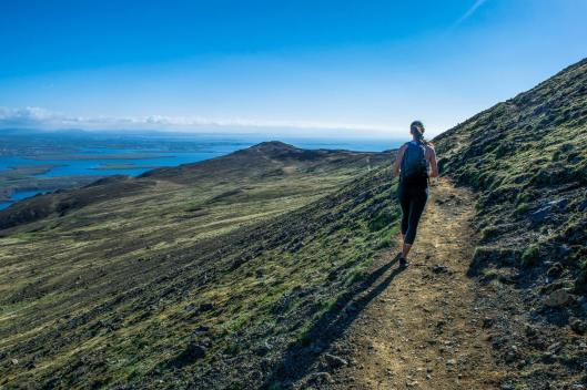 Legs hikes the trail on Esja. Esja is known as Reykjavik's mountain. Locals look to it to predict the coming weather, and it's hard not to define yourself with something so beautiful, looming over your city.