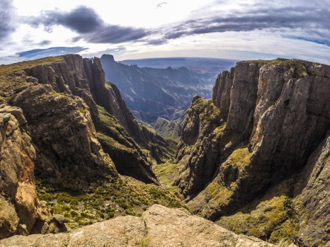 Looking down a precipitous ravine in the High Drakensberg. The rim of the Amphitheater is riddled with this deep cuts. From down below the wall looks almost solid, but when walking on top, the rim undulates like a snake.