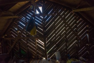 Light coming through the slats of Over Mountain Shelter.